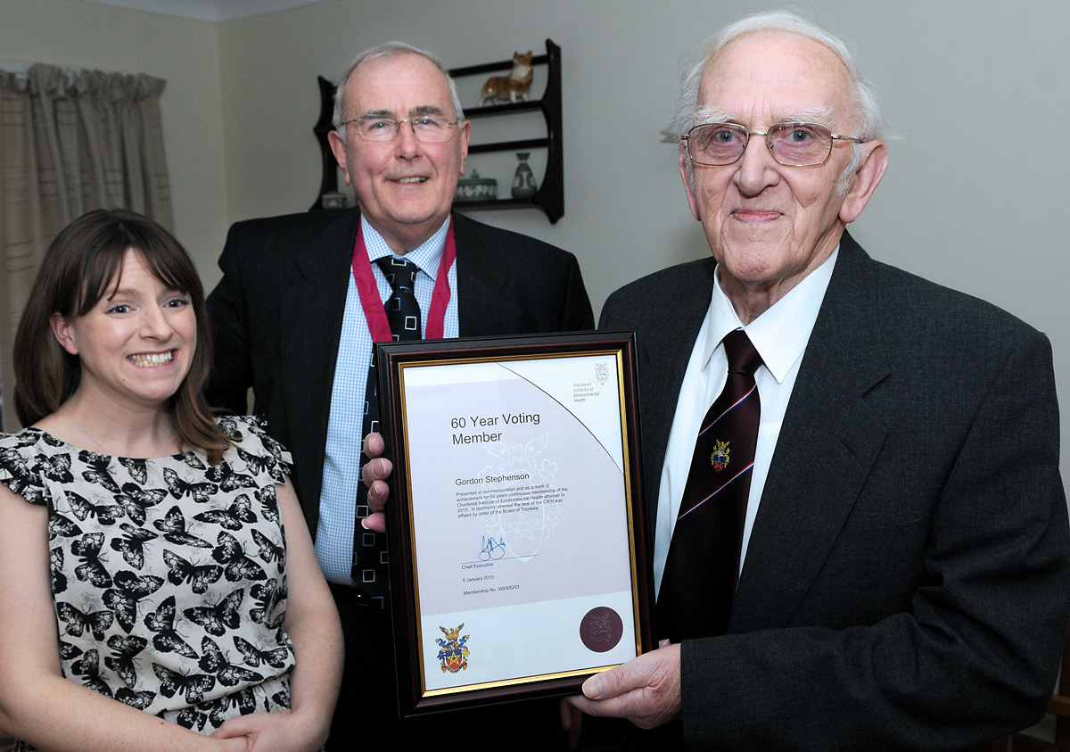 Gordon Stephenson, right, marks 60 years  as a member of the Chartered Institute of Environmental Health, with Sally Hill, branch     secretary of Hull and East Riding, and Yorkshire and David Purchon, secretary for the Humber region