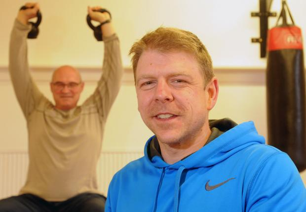 Personal trainer Paul Piercy works with client Ken Lech at Body and Soul, in Malton