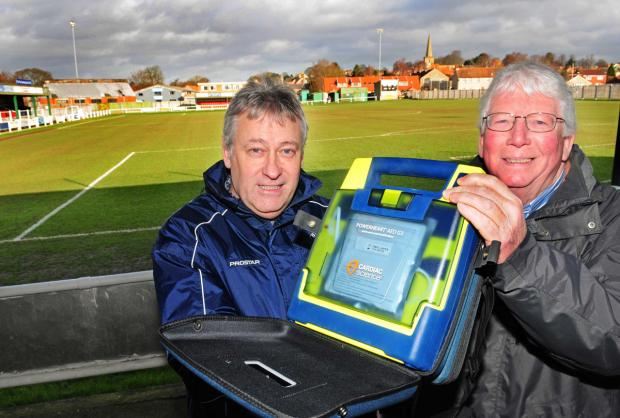 Pickering Town FC management committee members Pete Dickinson and David Pasley with the club's new defibrillator