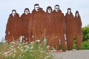 This memorial is a sculpture in metal of seven figures in silhouette representing bomber crews of 158 Squadron