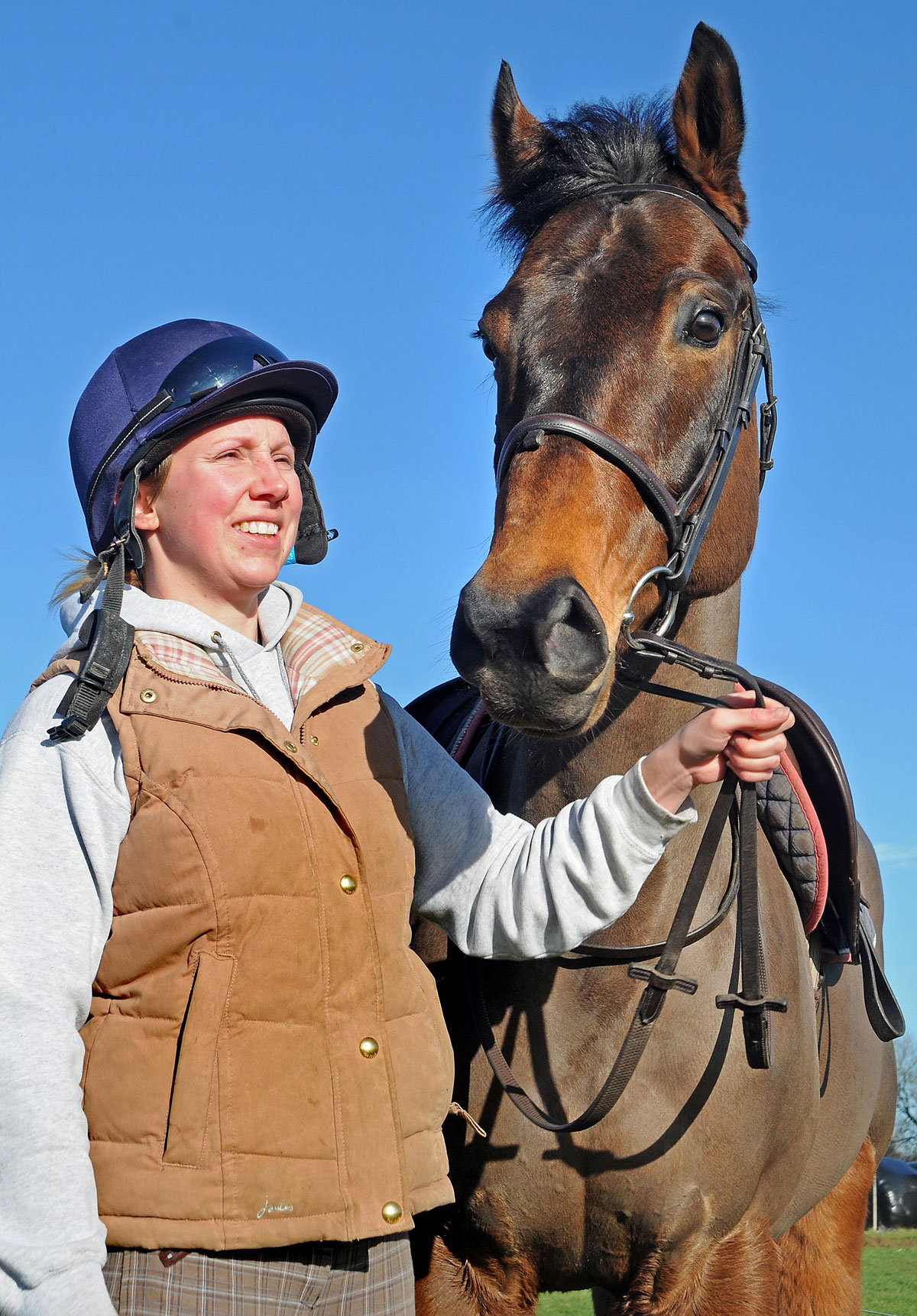 Lauren Dobson with her horse Ted. Lauren is to ride in the Macmillan Charity Race Day at York Racecourse in June and could win her weight in champagne