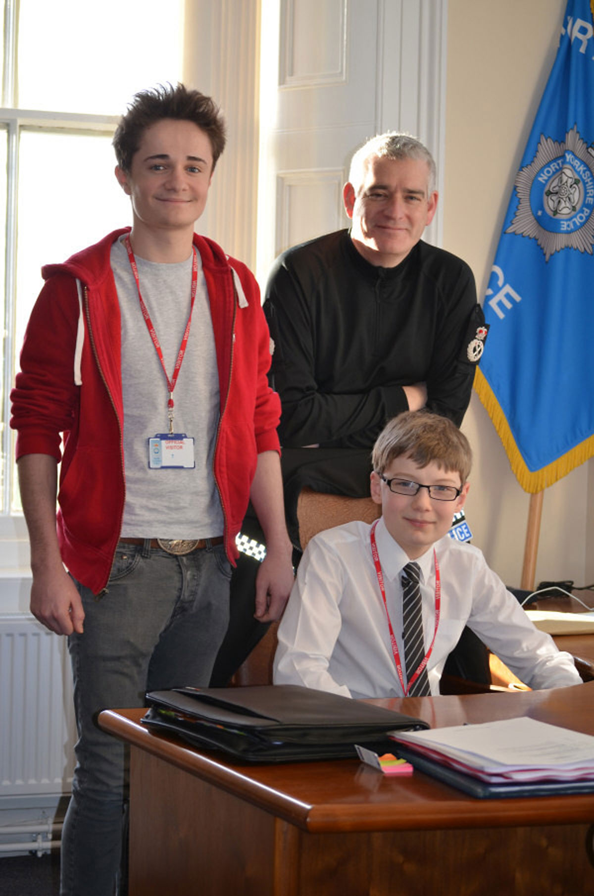 Chief Constable Dave Jones lets two pupils takeover his office