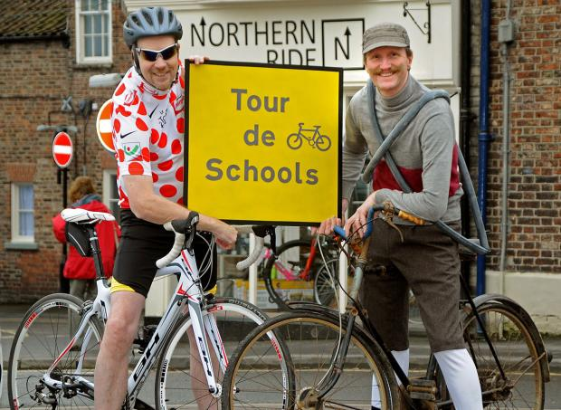 Authors Andy Seed, left, and Mike Barfield outside Northern Ride in Malton. The two are doing a tour around local primary schools a