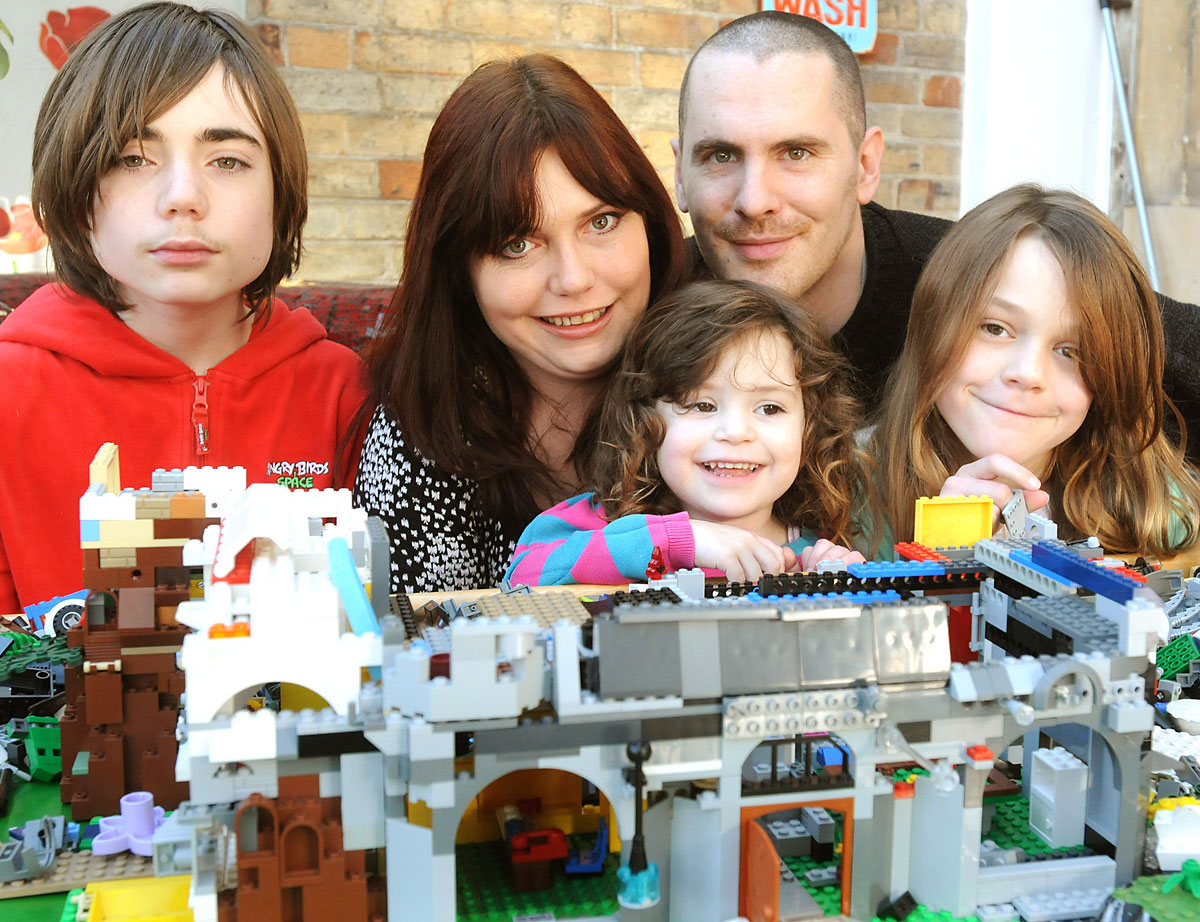 Mum Of The Year nominee Martina Mercer builds a Lego house with her family, from left, Mitchell, 13, Percy, two, husband Justin and Poppy, nine