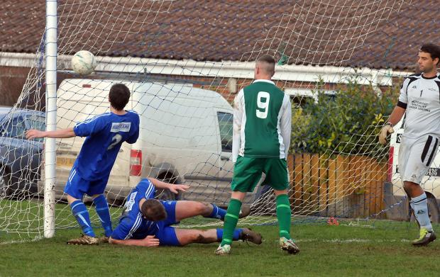 Wigginton number nine Lee McQuade watches the ball cross the line after fellow striker Lee Stewart's chip beat Terrington Glory 'keeper Mark Taylor in the premier division