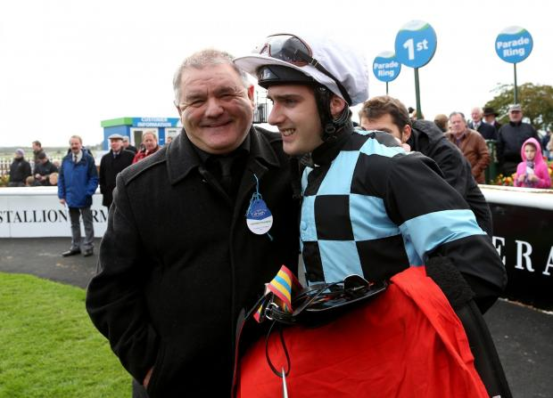 Jockey Robert Tart with trainer Brian Ellison after riding Montefeltro to win the Tote Super Trifecta Irish Cesarewitch during Irish Cesarewitch Day at the Curragh Racecourse, Co Kildare, Ireland.