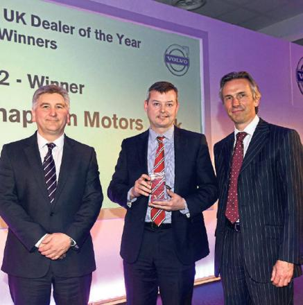 Volvo Car UK managing director Nick Connor (left) and sales director Jon Wakefield (right) present the trophy to dealer principal Duncan Chapman