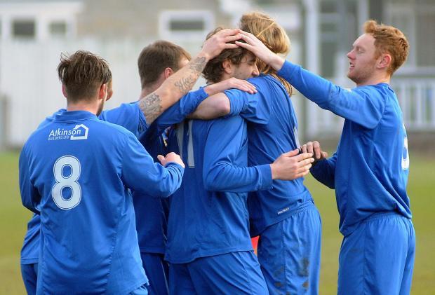 Pickering Town's Josh Greening, centre, is congratulated after scoring the opening goal in his side's 2-1 home win over Parkgate in the Northern Counties East League premier division
