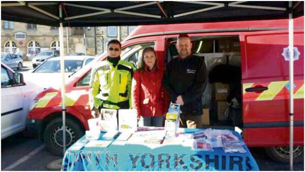 Andrew Santon (NYCC Road Safety Officer), Gail Cook (Ryedale District Council Community Partnership Officer) with motorcyclist Paul Cuthbertson at the safety event held in Helmsley