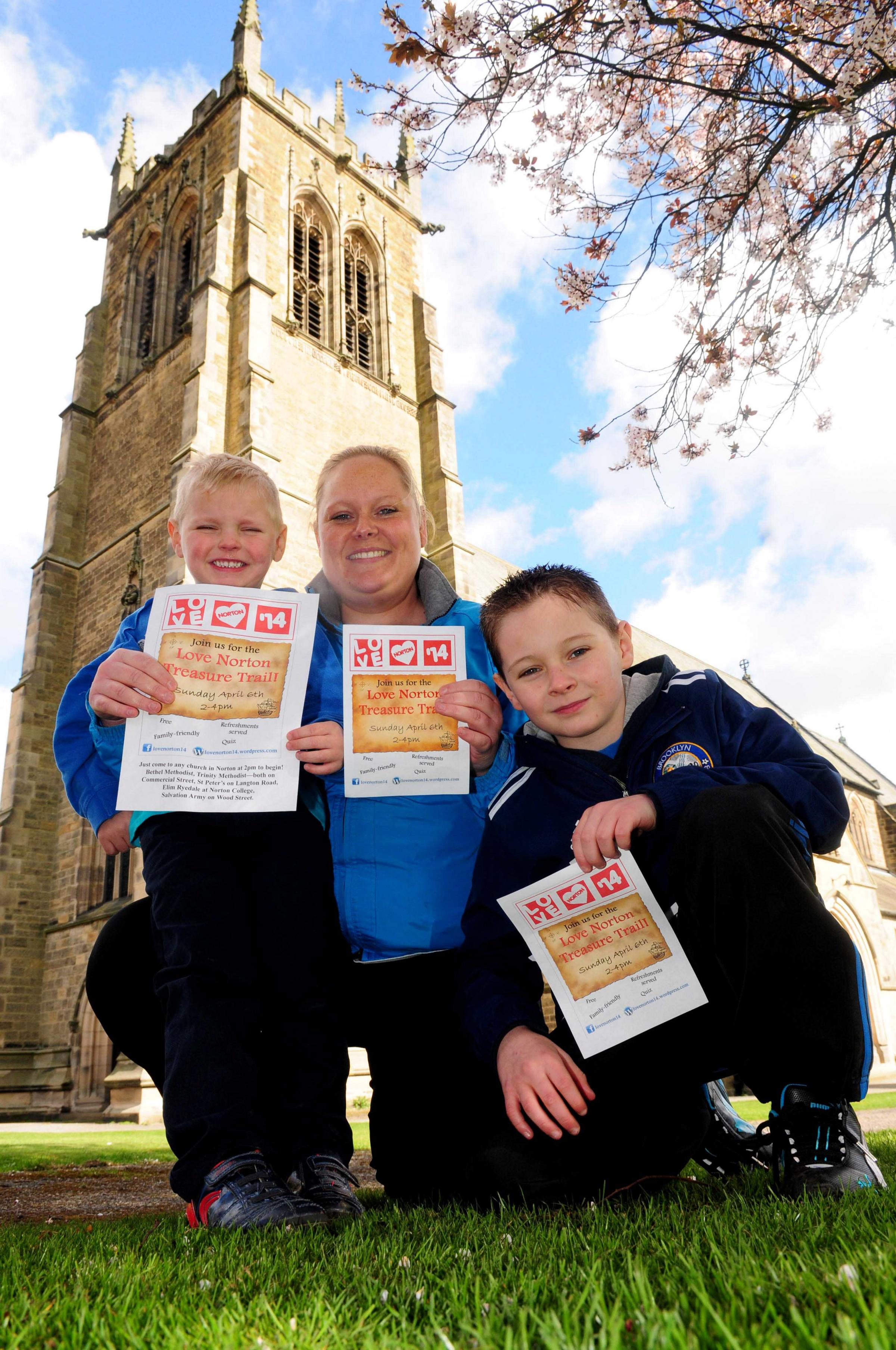 Jayne Gregg with her children Luke and Matthew Smithson promoting a treasure hunt as part of Love Norton 14