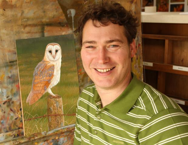 Artist Robert Fuller with one of his paintings