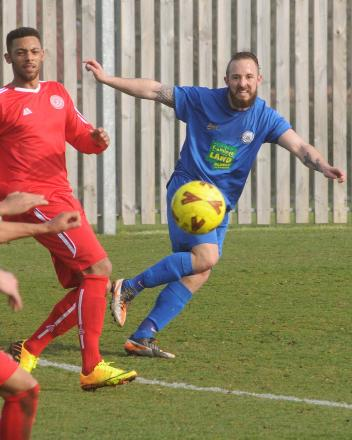 Pickering Town's Robbie Hawkes fires in an effort against Parkgate