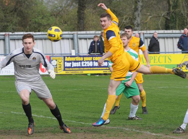 Tadcaster Albion (yellow) v Glasshaughton Welfare (green). Pictured in first half action is Tadcaster's Nick Thompson. Picture David Harrison.