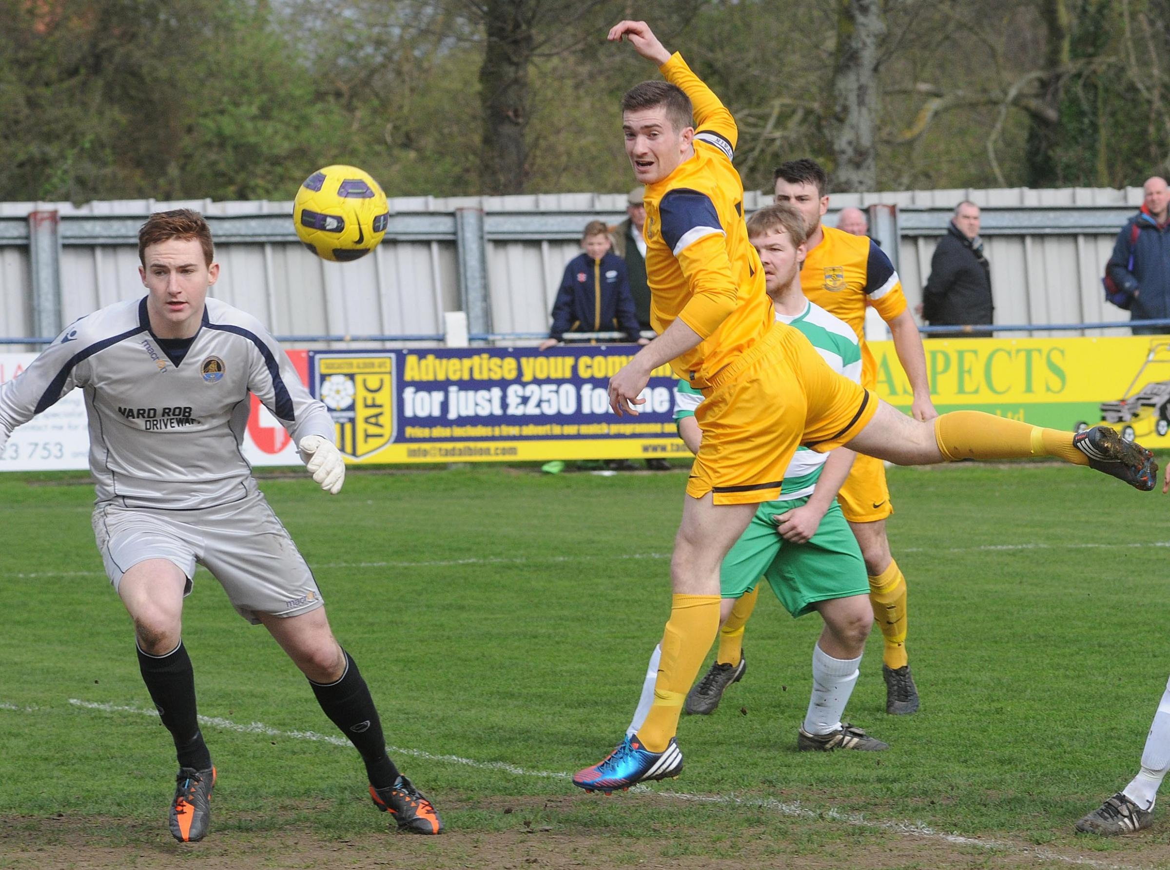 Tadcaster Albion (yellow) v Glasshaughton Welfare (green). Pictured