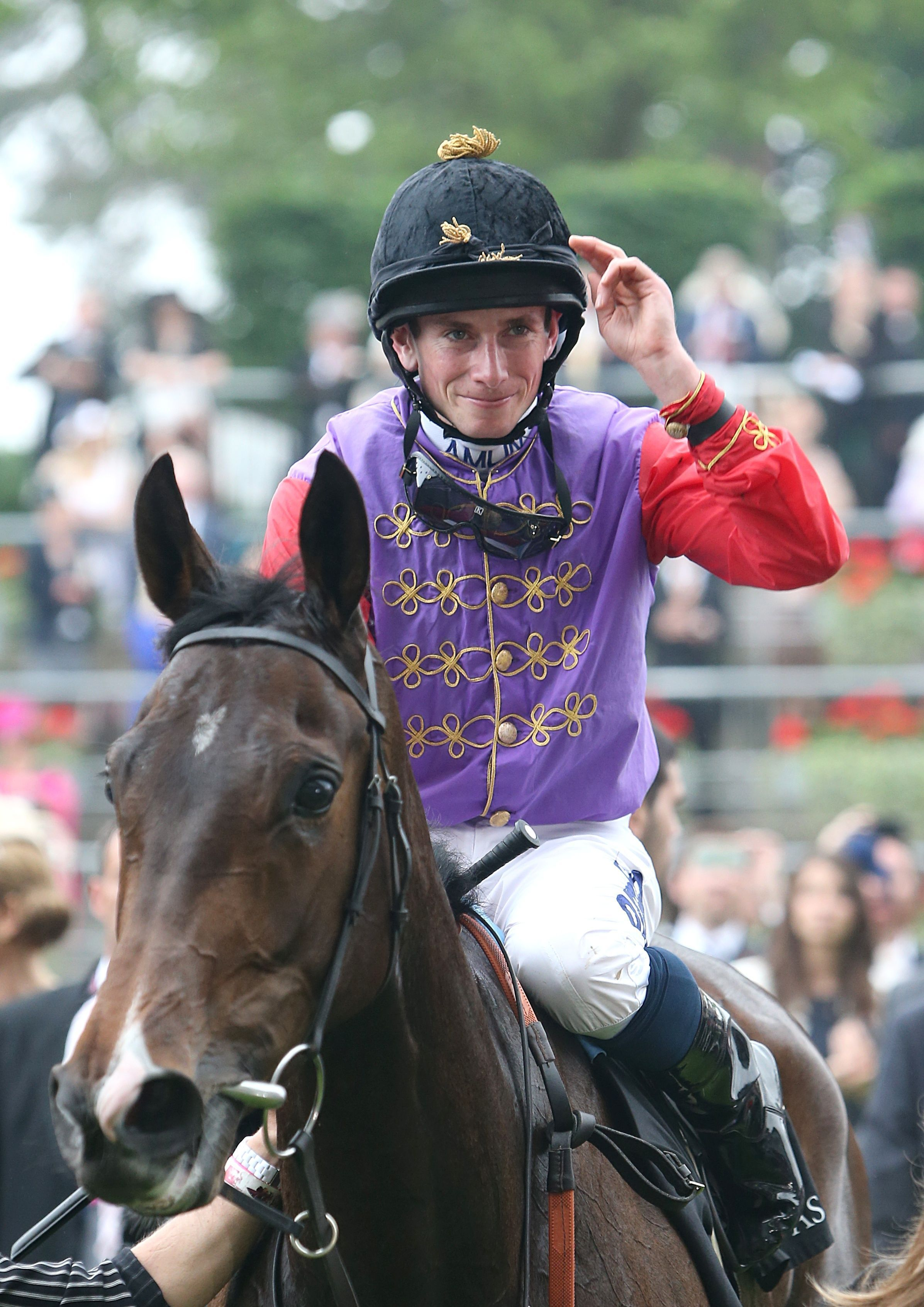 Jockey Ryan Moore atop Estimate arriving in the winners enclosure after winning the Gold Cup during Ladies' Day at Royal Ascot.