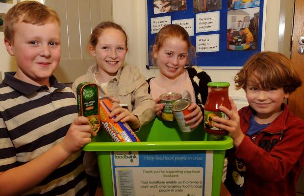 Settrington Primary School pupils William Lightfoot, Lily Popham and Poppy and Beck Hutchinson pack a box for the Ryedale Food Bank