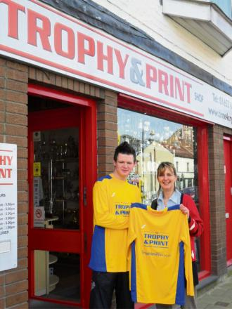 Pickering Knights have a new away kit sponsor in The Trophy & Print Shop. Pictured are Knights top scorer Steven Carter with Jane Stevens, representing Alan Rudgard from Trophy & Print