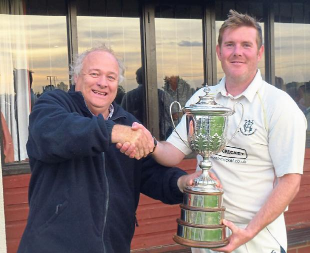 Hunters York and District Senior Cricket League secretary and treasurer Rob Richtering, left, presents the premier division trophy to Woodhouse Grange captain Steve Burdett