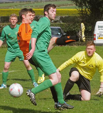 Gillamoor's George Oyston, left, and Heslerton's Jermain Timms, both miss the ball in a goalmouth clash