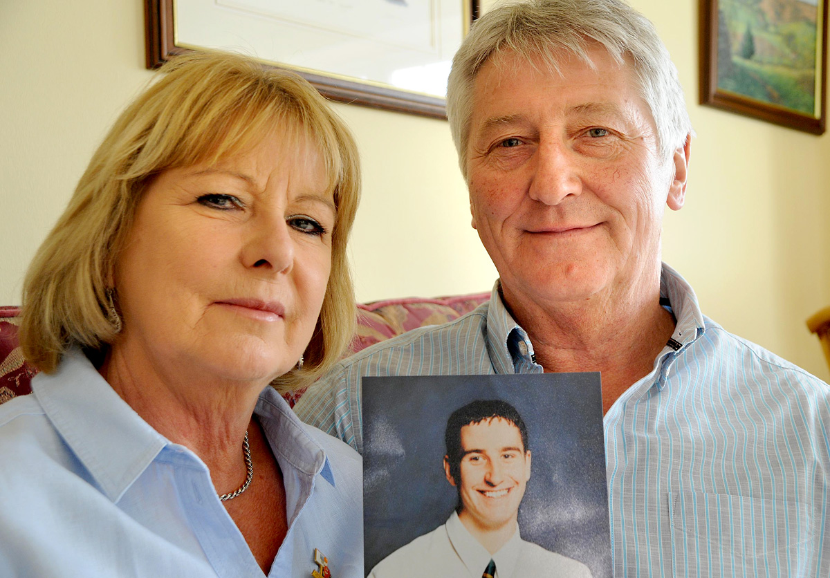 Allan and Marje Scott, of Beadlam, holding a photo of their son, Mike, who died in 1996