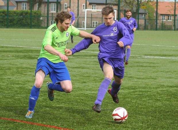 Gazette & Herald: Brooklyn's Richard Webster, left, and St Clement's Dan Hickey, right, battle for possession in their York Minster Engineering Football League Senior Cup clash, which Brooklyn won 2-0 to advance to the semi-finals