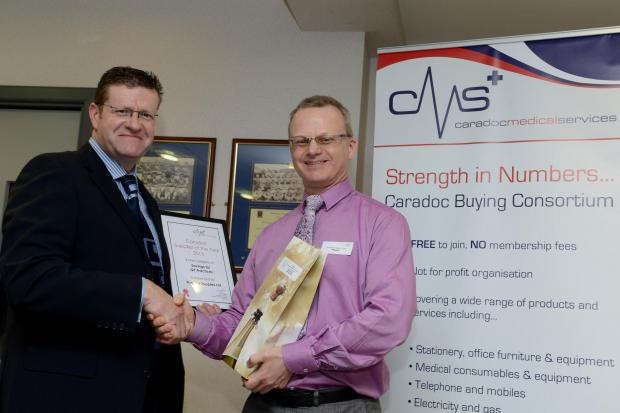 Practice Supplies co-owner Julian Barnes is presented with the award by Dr Russell Muirhead