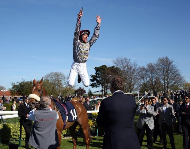 Frankie Dettori does a flying dismount after riding Sandiva to beat Euro Charline in the Nell Gwyn Stakes at Newmarket. Picture: Steve Parsons/PA Wire
