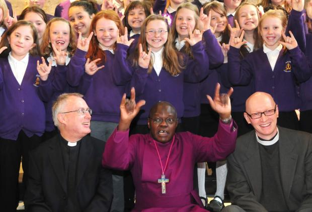 Gazette & Herald: The Archbishop of York, Dr John Sentamu, with the Venerable Paul John Ferguson and the Rev Canon Dr John Bromilow Thomson with pupils from Archbishop of York's Infants School