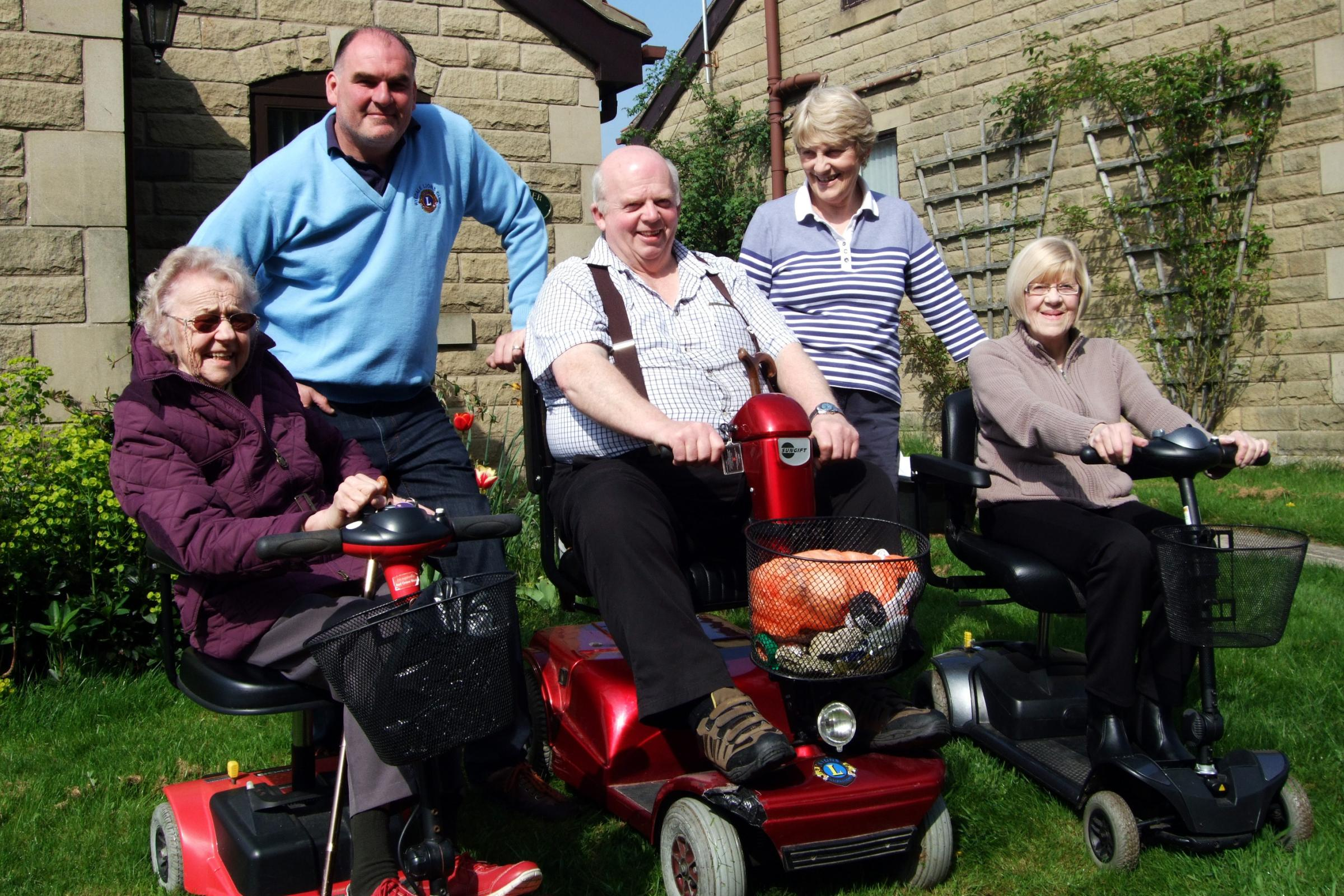 Tim Pickering, Ryedale Lions scooter manager and Almshouse Clerk Margaret Fletcher with scooter riders (left to right) Dorothy Bell, Steve Swires and Gill Davies.