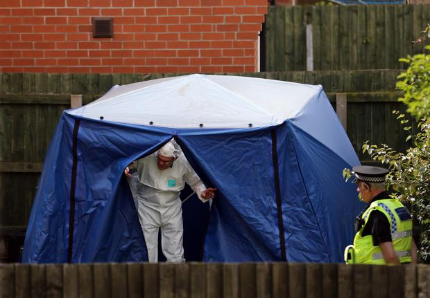 Gazette & Herald: An officer leaves the forensic tent at Burnholme Grove today.