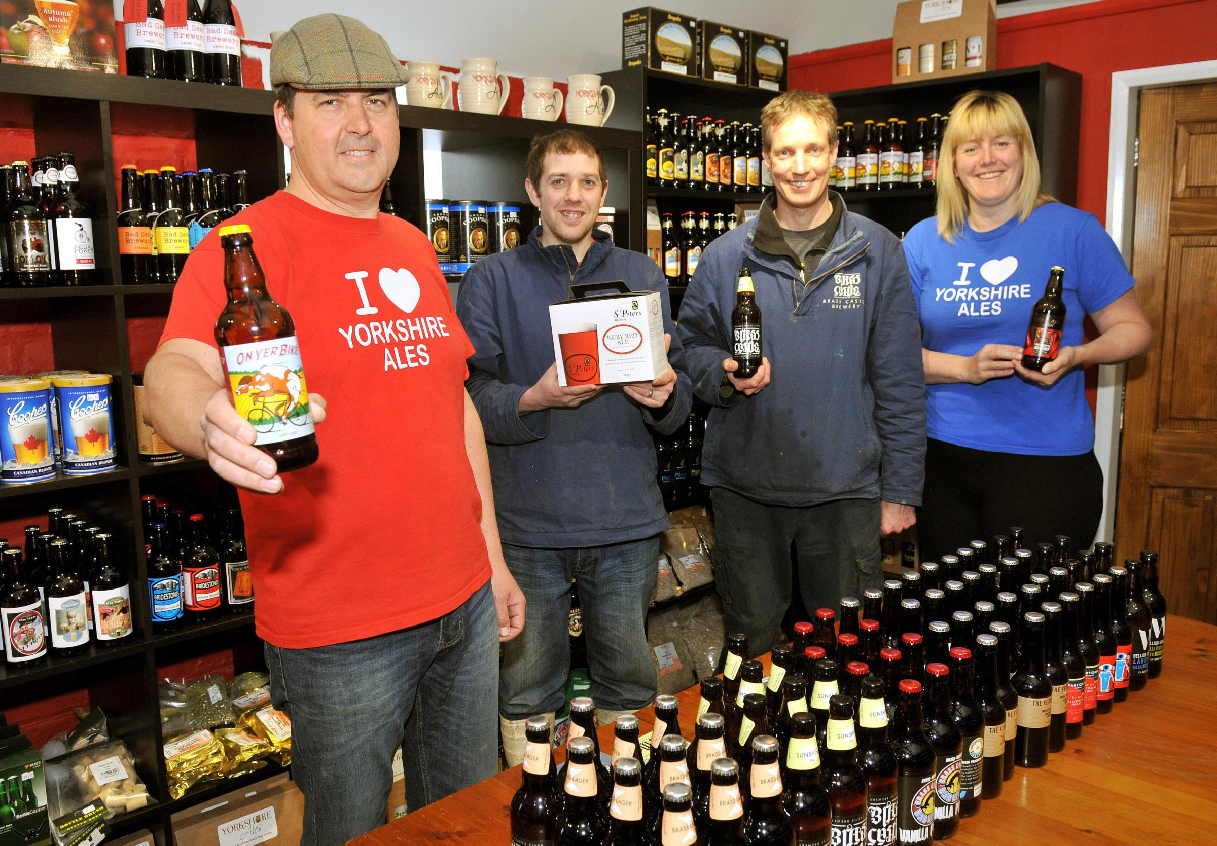 Matthew Hall and Phil Saltonstall at the opening of the Yorkshire Ales shop at Brass Castle Brewery Malton, watched by Adrian Pettitt, left, and his wife, Vicky