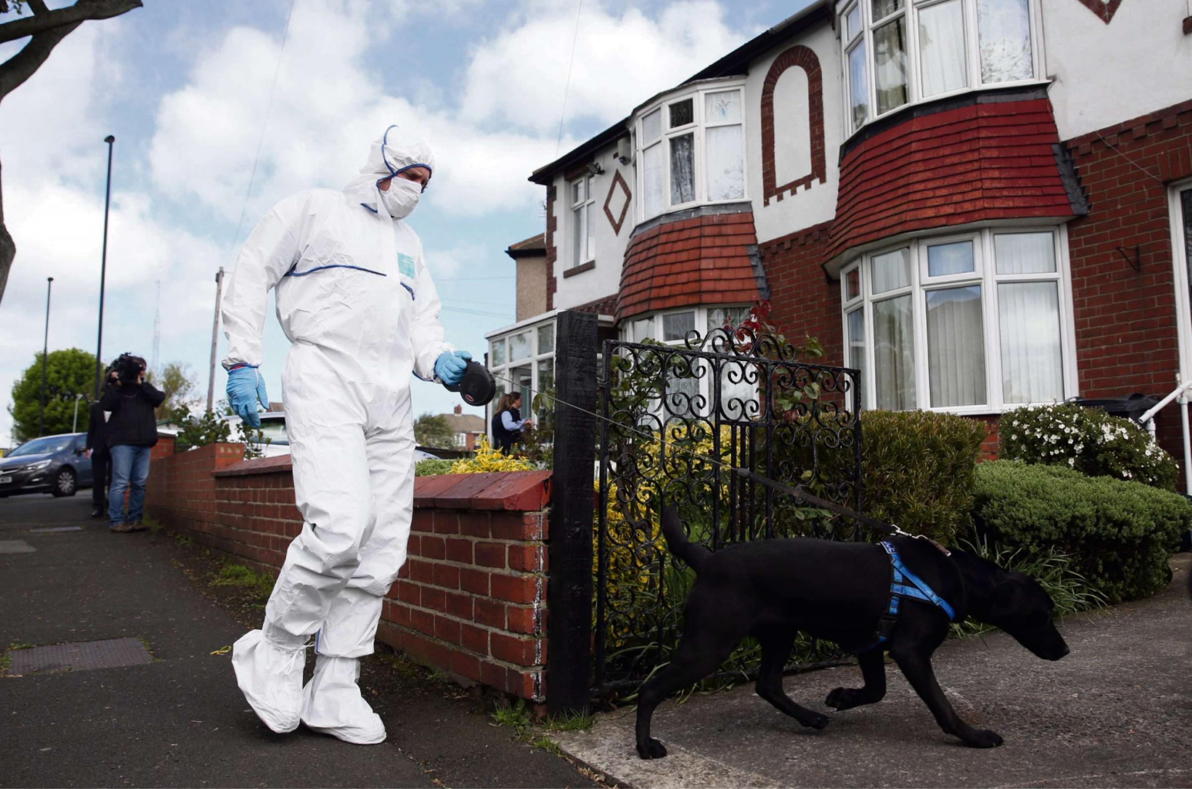 Police and dogs at the house in Hollywell Road, North Shields, the family home of Mike Snelling
