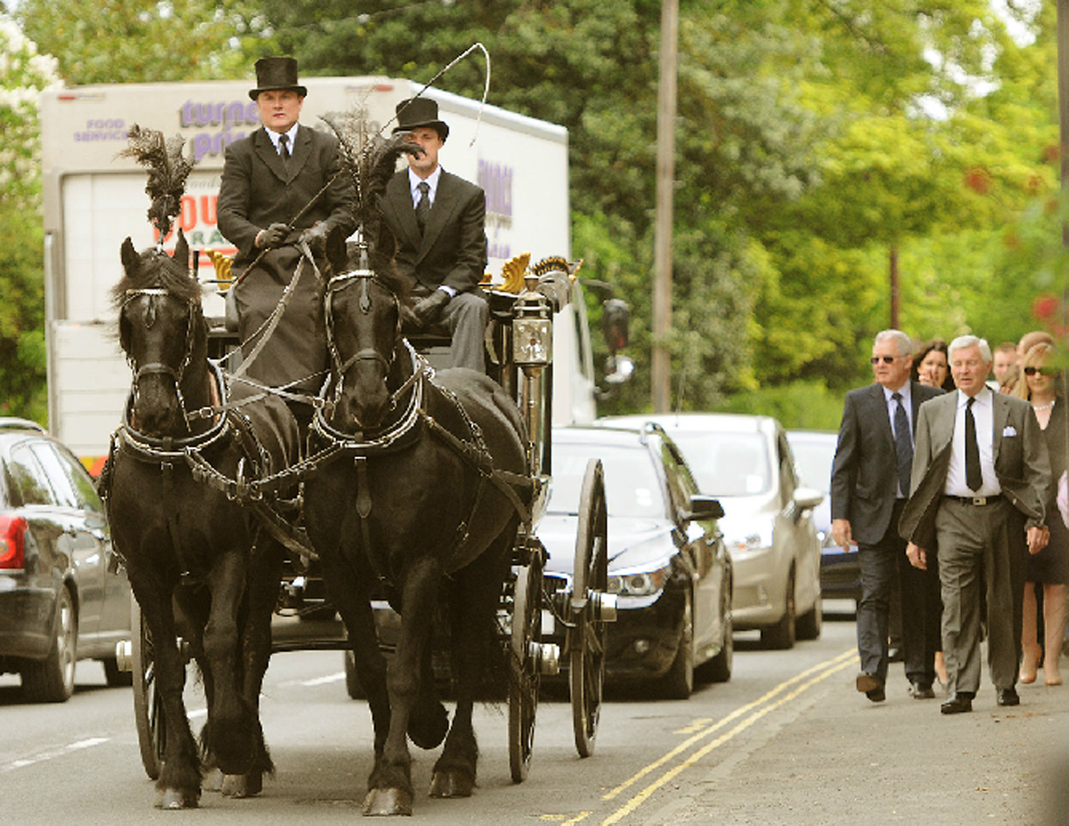 Michael 'Mick' Eddery's horse drawn hearse proceeds to St Leonard's RC Church in Malton
