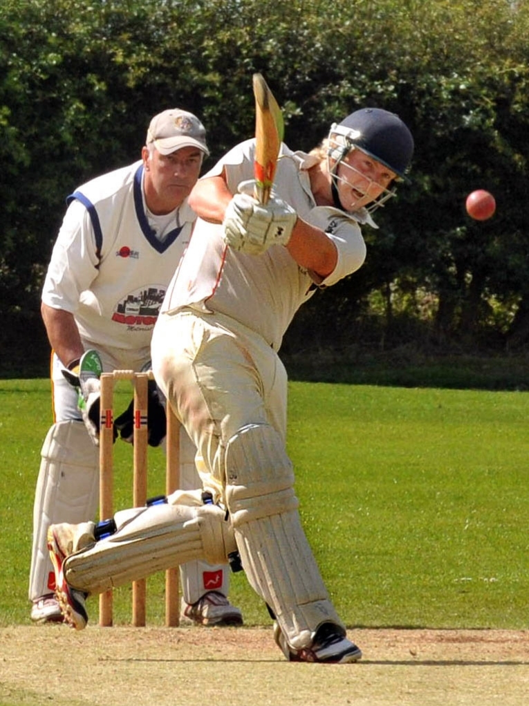 Woodhouse Grange batsman Chris Bilton hits another four watched by  Strethouse wicket keeper  Paul Langley.
