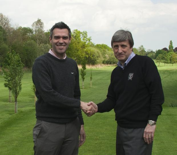 WELCOME BACK: Alistair Burns, left, is greeted by outgoing Pike Hills club secretary David Winterburn