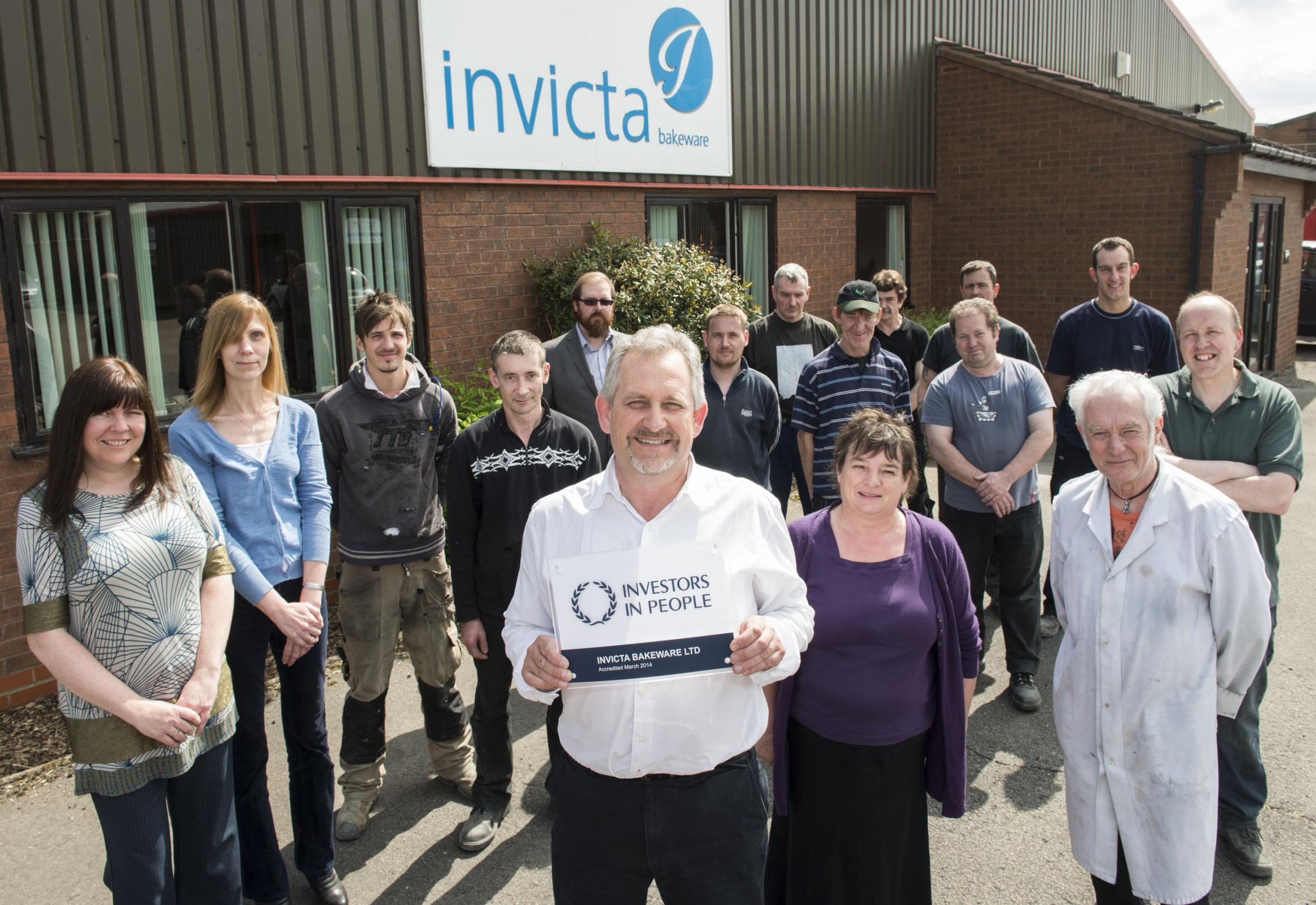 Smiles all round for staff at Invicta Bakeware: John Waddington, Managing Director, displays the prestigious Investors in People award.