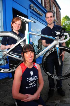 Cyclist Lisa Fenwick with Nicola Doody and David Trotter of Giant, sponsoring Lisa