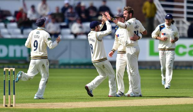 Gazette & Herald: Liam Plunkett celebrates with his Yorkshire team-mates
