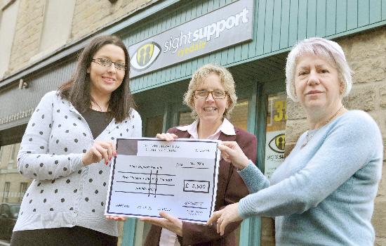 Vicky Stott, left, and Janice Every, right, from Sight Support Ryedale, receive a cheque for £2,500 from Faith Young, from the Earl Fitzwilliam Charitable Trust