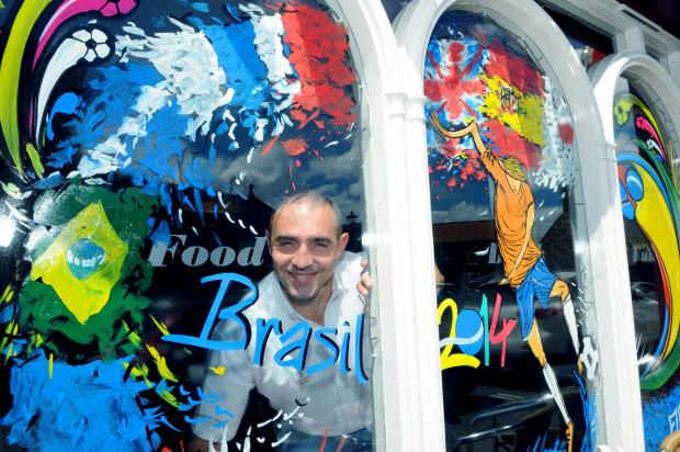 Kini Fernandez, manager of The Yard in Malton, with the World Cup-themed painted window