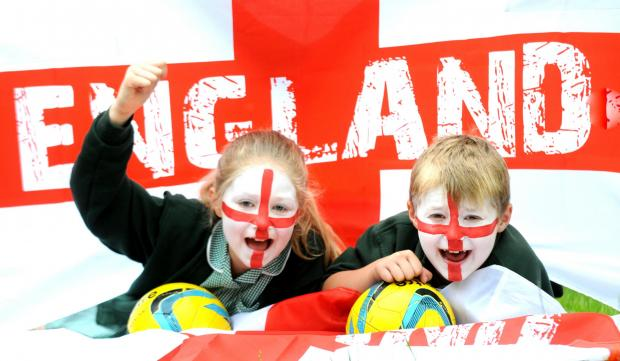 Malton Primary School pupils MIllie and Kyle , both aged eight,  prepare for World Cup party at the school