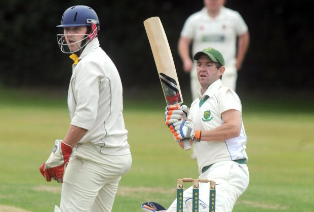 Gazette & Herald: Stamford Bridge batsman Matt Beckett in action in the York & District Senior League premier division, watched by Easingwold wicketkeeper Kyle WaitePicture: Mike Tipping