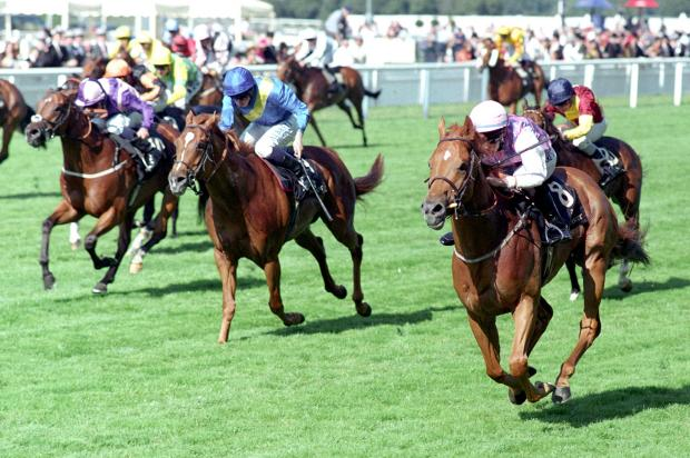 Baccarat (No.8), ridden by George Chaloner, powers to victory in Saturday's Wokingham Handicap at Royal Ascot