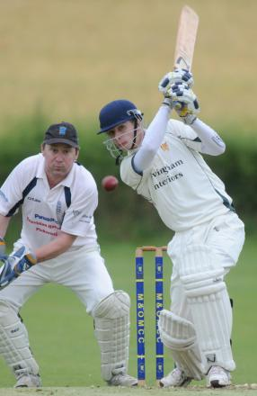 Malton and Old Malton batsman William Spencer drives for four watched by Pickering wicket-keeper Chris Nichols
