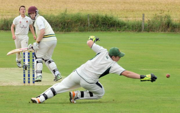 Malton & Old Malton II batsman Martin Woodliffe looks back to see Easingwold II keeper Danny Thornton dive for the ball. Easingwold II went top of division three south after winning by three wickets