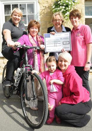 Back, second from right, Faith Young, from the Fitzwilliam Estate, hands over a cheque to the April Benton Fund, watched by April Benton, front, and staff from Housemartins Nursery Vicki Allan, Marsha Turnball, Amanda Beecham and Julie Twamley