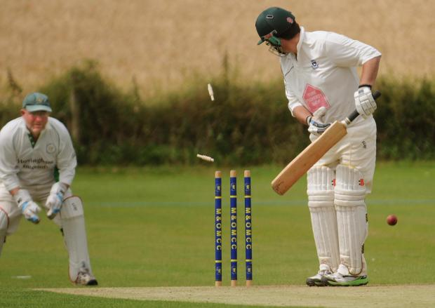 Gazette & Herald: Selby batsman Gary Moore watches his bails fly after a delivery from Malton & Old Malton bowler Wayne Dawson