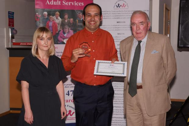 Iain Pearson, centre, was presented with his award by trustee Kate Stead and chairman of the trustees, Tony Denness