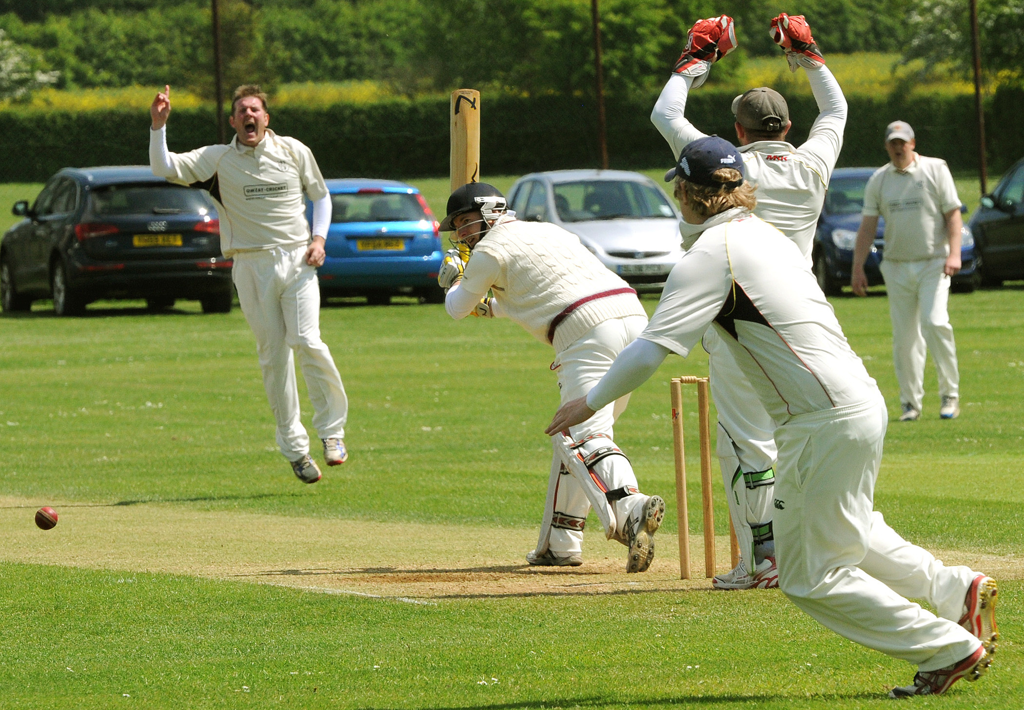 Sheriff Hutton Bridge batsman Robert Pinder plays the ball away much to the frustration of Woodhouse Grange bowler Steve Burdett and keeper Mike Burdett  during the match at Woodhouse Grange.