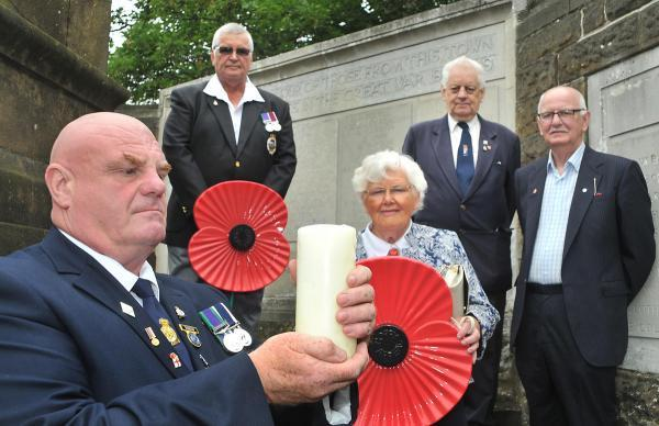 Members of the Royal British Legion, from left, Shaun Brosman, John Woodward, Margaret Preston, David Tolson and Paul Farndale, at Malton War Memorial preparing for the Lights Out campaign to mark 100 years since the start of the First World War